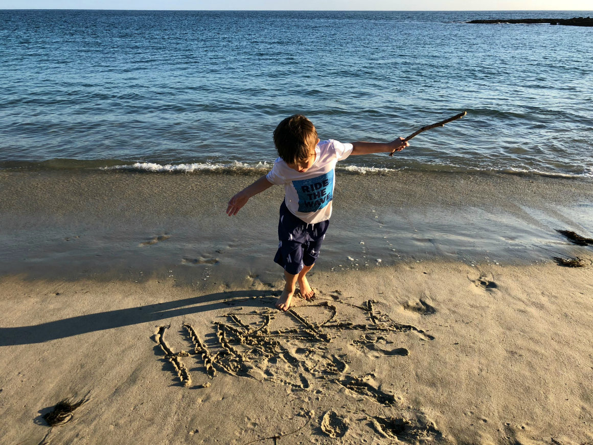 playing on the beach at Montage Laguna Beach - well traveled kids